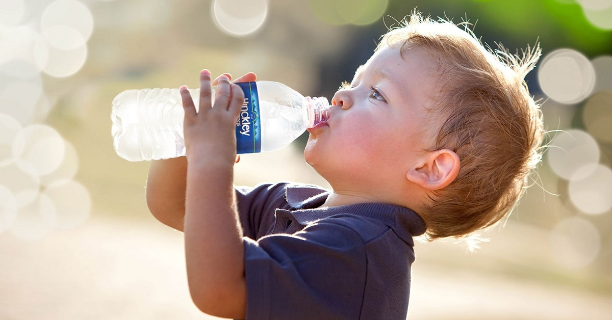 Child drinking mineral water